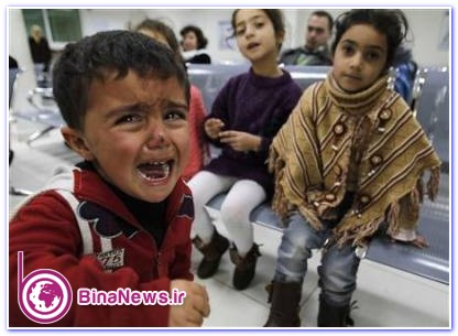 A Syrian child cries as his cousins watch at the United Nations High Commissioner for Refugees (UNHCR) office in Amman